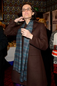 Secretary of State for Northern Ireland Theresa Villiers fashions a scarf from the Giants Causeway Tartan range